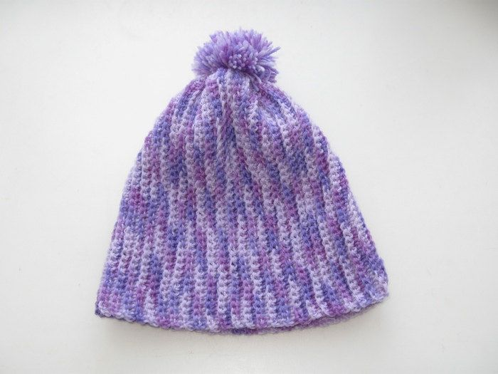 Children's hat crochet from half-woolen yarn, decorated with pompons, it will be a wonderful gift for the holiday. Perfect for walk and for outdoor games.