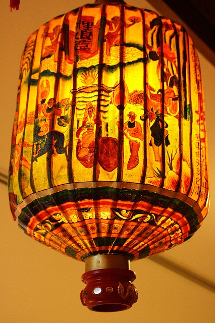 Peranakan Lantern, usually hung outside the house, some with the family surname character written.
