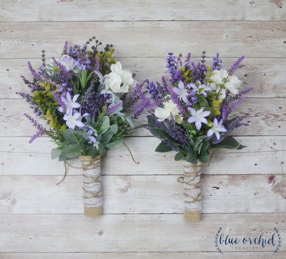 This bridesmaid bouquet is full of lavender, purple wildflowers, ivory/cream flowers, and greenery. Absolutely perfect for a rustic or boho wedding. This picture shows the large and medium size bridesmaid bouquets. Shown wrapped in burlap with a cream lace overlay, this boho wedding bouquet is about 10-12 tall. The large bouquet is about 9-10 in diameter, and the medium bouquet is about 7-8 in diameter. This listing is for one BRIDESMAID bouquet. You can choose the size and quantity at c...