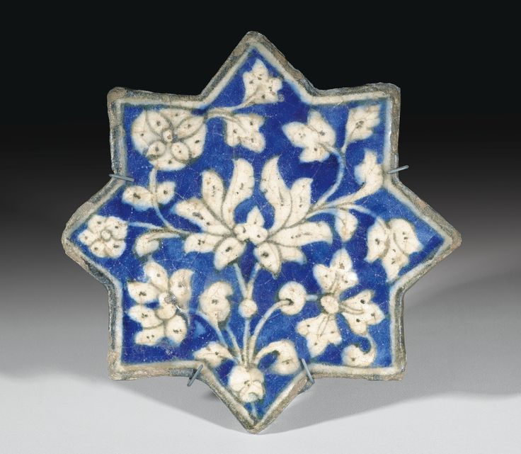 An Ilkhanide pottery star tile, Persia, early 14th century