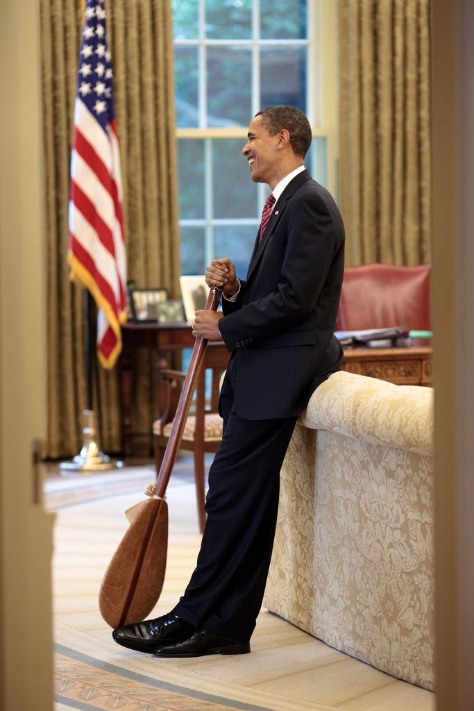 President Barack Obama stands in the Oval Office with a Hawaiian paddle that was given to him as a gift by chef Allen Wong, who catered the 2009 Presidential Luau, June 26, 2009. (Official White House Photo by Pete Souza)  Most iconic Pete Souza photos of Obama family's first 4 years in the White House     #52