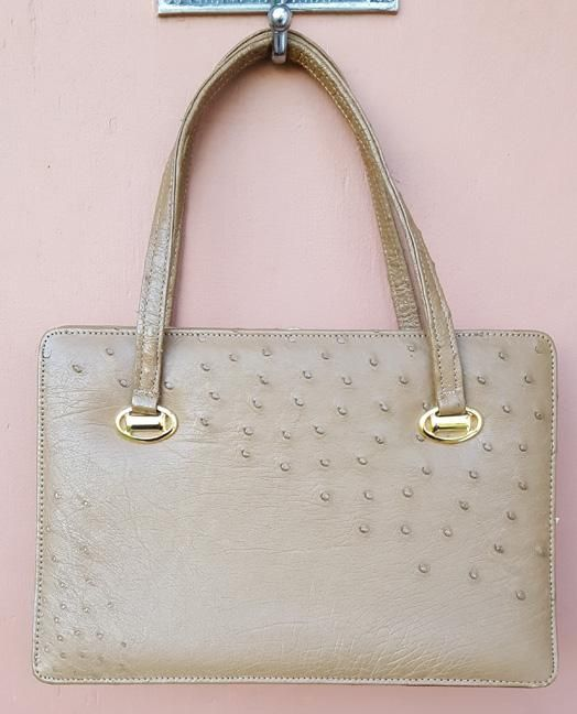 bb645ce55 This is a gorgeous 1960s Ostrich leather purse, a perfect taupe color is in  minty, minty condition. Excluding the handles it measures: 11 inches X