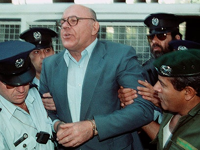 """Struggling with Israeli guards in 1988, John Demjanjuk of Cleveland, Ohio, shouts his innocence: """"I am not Ivan the Terrible!"""" Though born in the Ukraine, the naturalized American denied he had been a brutal guard at Treblinka. He was allowed to return home. But recent Soviet evidence indicates Demjanjuk lied about his past, and he could face loss of his citizenship."""