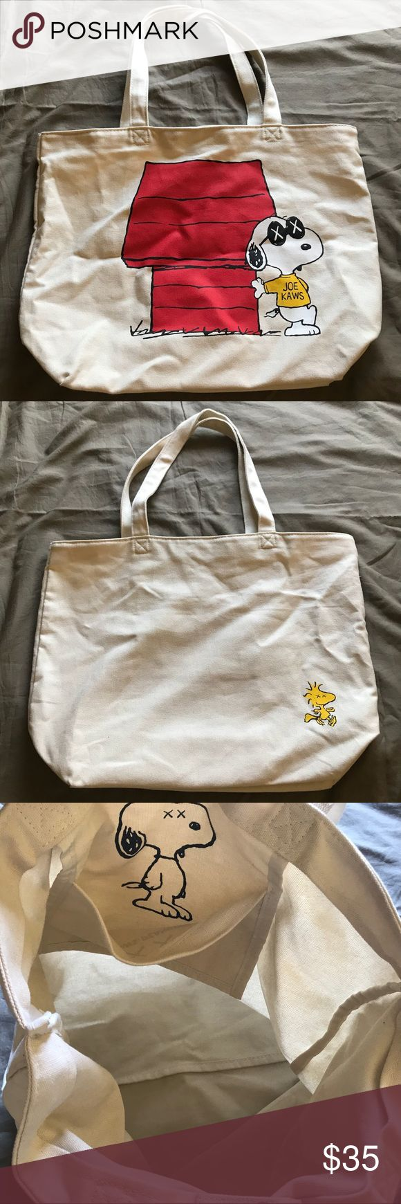 Uniqlo - Kaws x Peanuts Collaboration Tote Bag Kaws x Peanuts Collaboration Tote Bag // Size: OS // Used once, but does not have any kind of flaws! Still in perfect condition. This item quickly sold out from Uniqlo when the collection dropped! Can easily fit textbooks, a laptop, etc. Uniqlo x KAWS Bags Totes