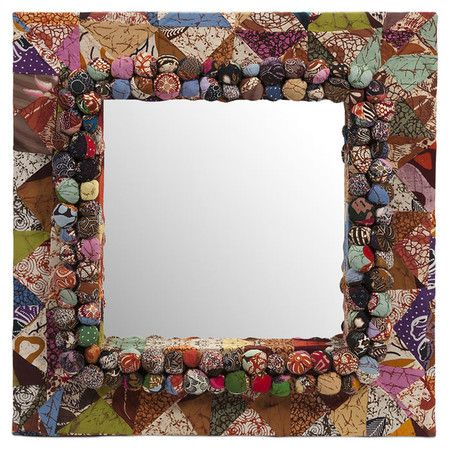 Wall mirror with an upcycled Batik fabric-wrapped frame and textured accents.  Product: Wall mirrorConstruction Mate...