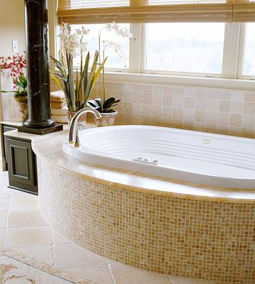 A trio of tile (floor, tub surround, and wall). And who wouldn't want to soak in that tub?
