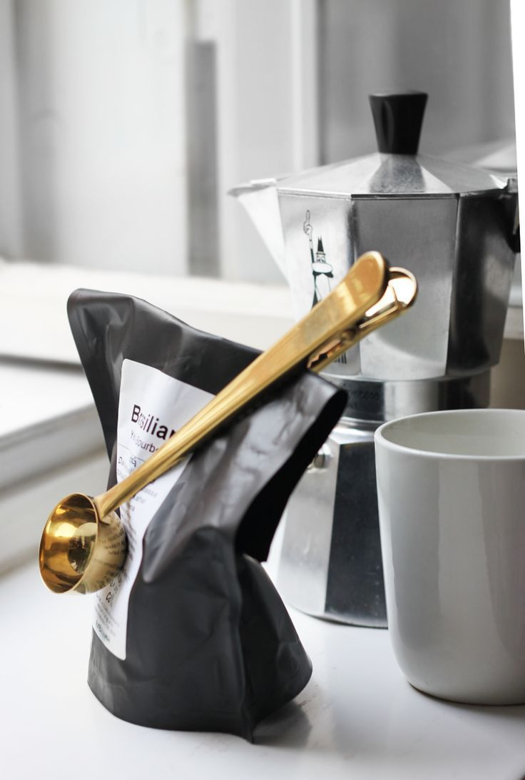 Coffee clip/scoop. Make it in silver and I'm even happier.
