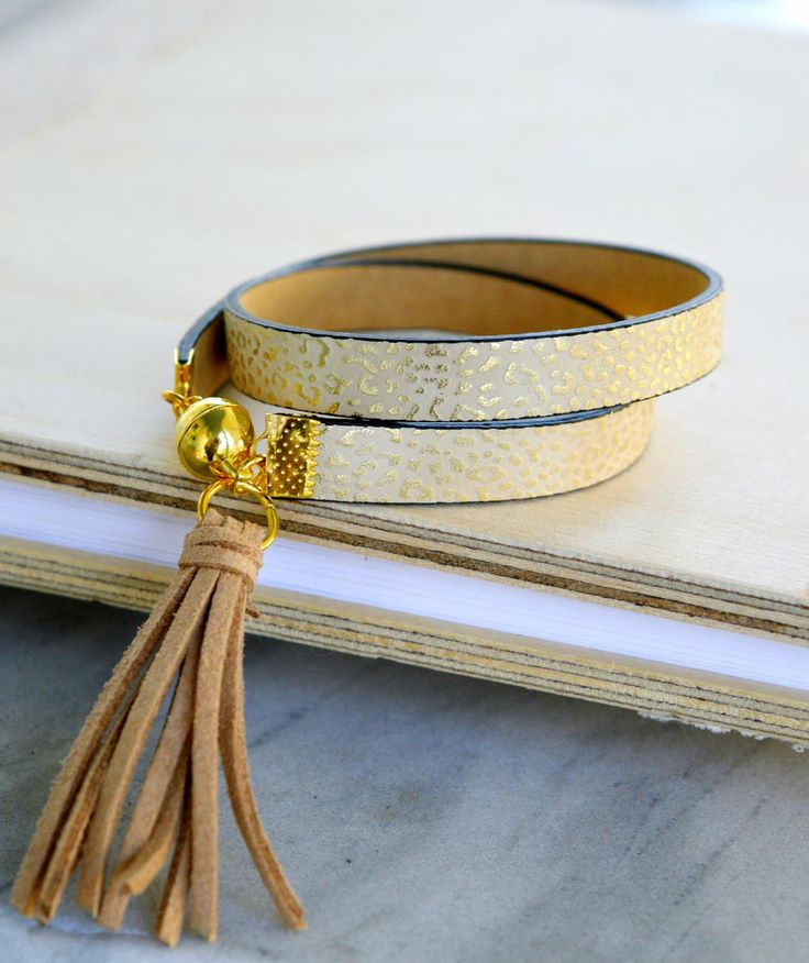 This Elegant Tassel Wrap Bracelet is the perfect boho chic summer accessory. DIY wrap bracelets are fantastic to wear all year round, but this specific leather and tassel bracelet make this perfect for those summer festivals.