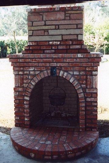 Add keystone in brick to fireplace surround | Outdoor fireplace patio, Outdoor fireplace ...