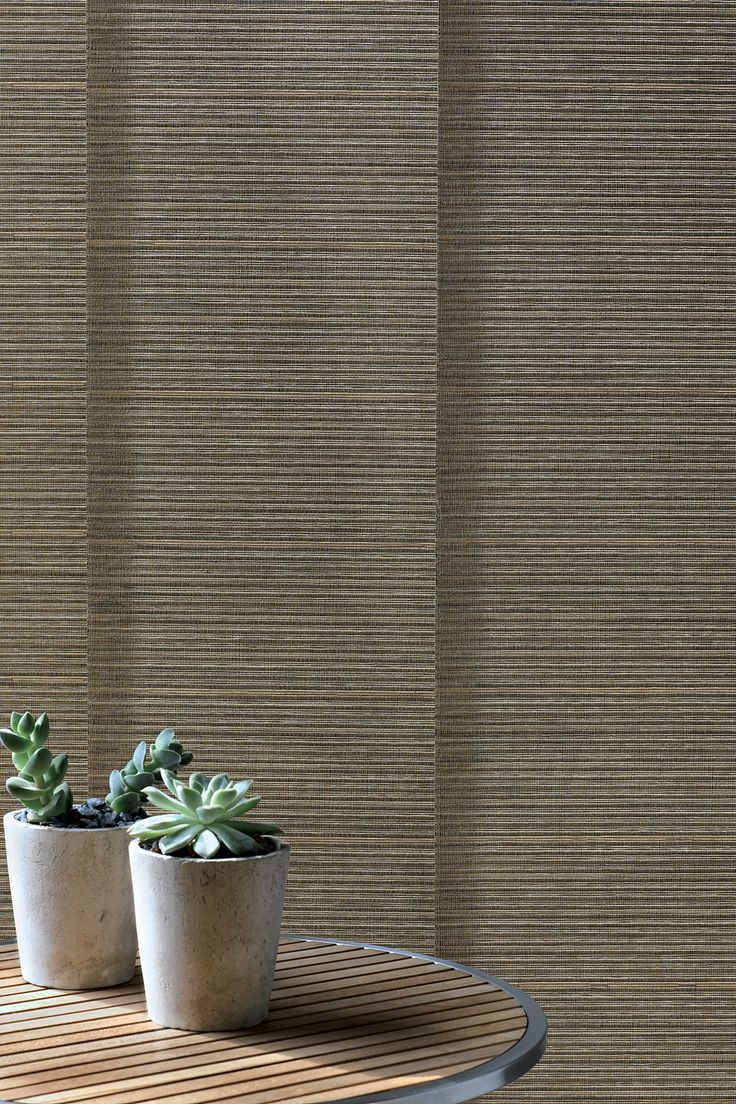 Ground yourself with the natural beauty and simplicity of Hunter Douglas Alustra® Woven Textures®  Skyline® Gliding Window Panels.  A contemporary window treatment for sliding doors and large window expanses.