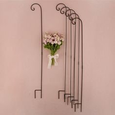Wedding Decorating Flower Holders Shepard Hooks Wedding decoration supplies feature 6 shepard hooks. These classic black multi-purpose hooks are intended to be inserted into the ground and are ideal for hanging candle holders, paper lanterns, flowers or many other decorations. Whether lining your wedding aisle or placed throughout your reception, these are a functional accessory with almost endless possibilities.