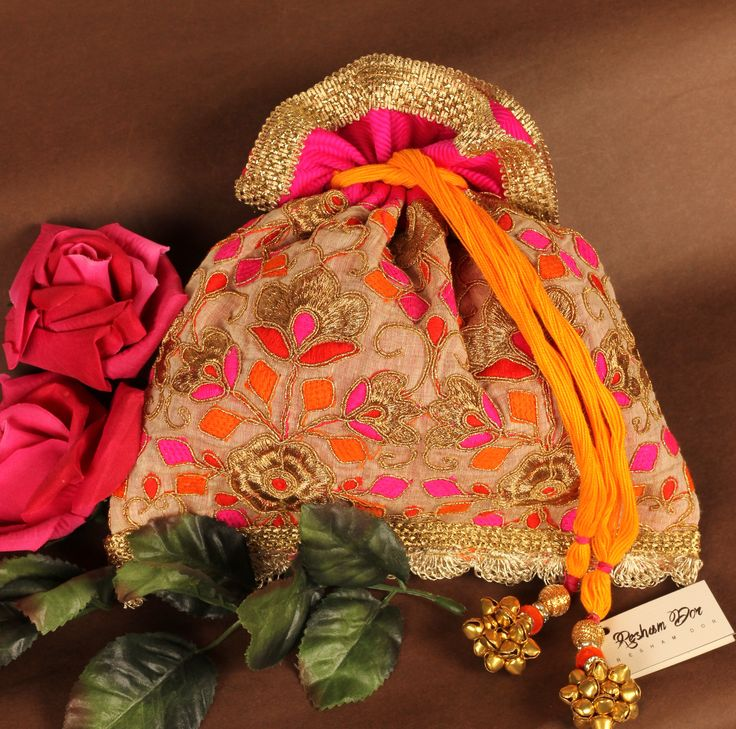 RD 1071-Utsav potlis in bright festive colours.                     Price: Rs. 1990