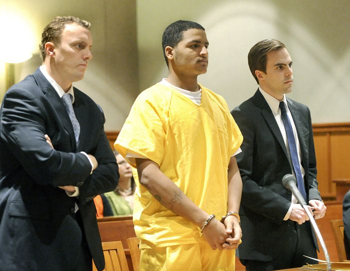 Flanked by attorneys Peter Cyr and Dylan Boyd, Anthony Pratt, 19, of Far Rockaway, N.Y., made his initial appearance in Cumberland County Unified Criminal Court in Portland on Friday to face a charge of murder for the death of Margarita Fisenko Scott, whose body was found last January in Portland.