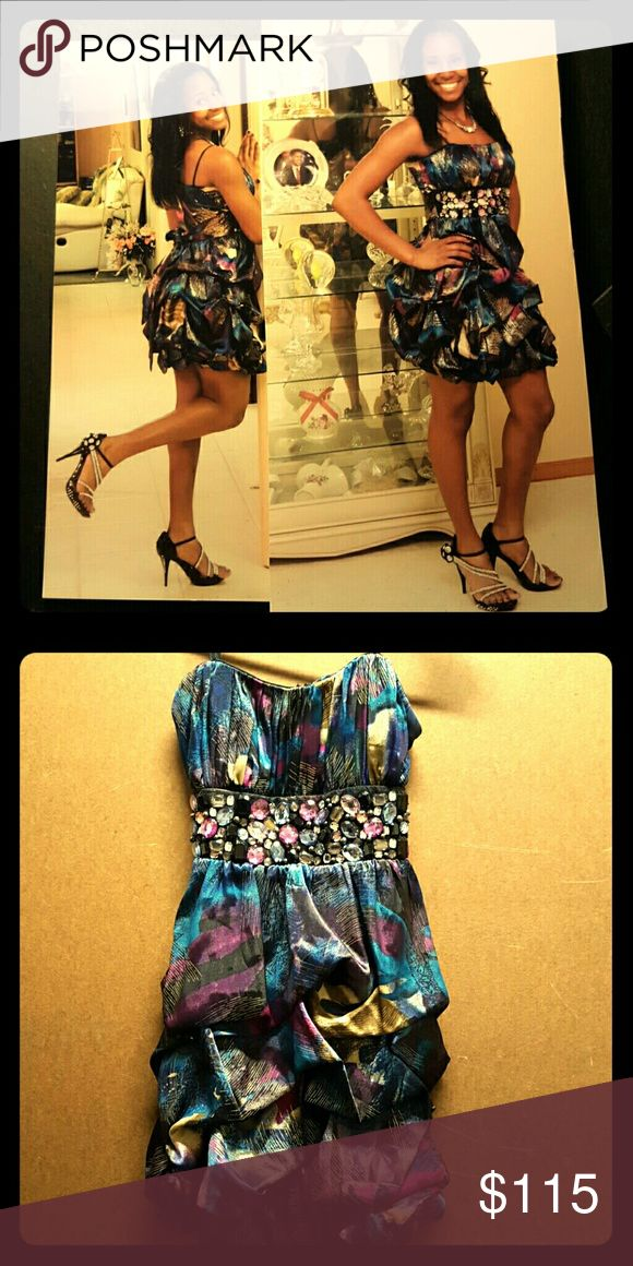 Fancy dress This bedazzled, strapless dress is eclectic and classy. It is patterned with deep tones of purple, blue, fascia, and gold. It has only been worn once to a winter formal dance. It is perfect for banquet occasions, a night at the club, or a wedding. City Triangles Dresses Wedding