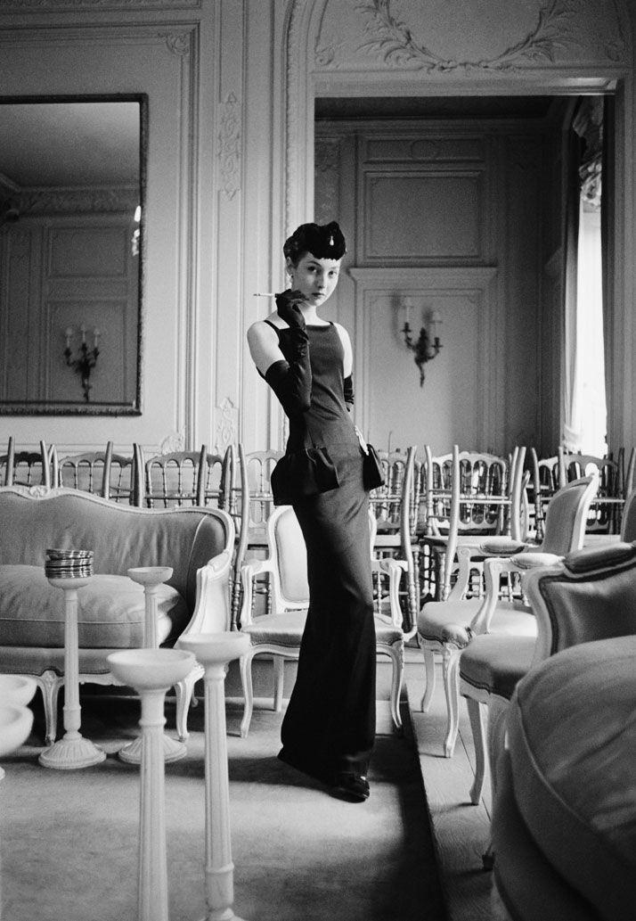 Two visions of Renée, one of Christian Dior's favorite models who represented his physical idéal. ''Every dress she puts on seems to be a success,'' he wrote in his memoirs. According to Victoire, Renée's proportions ''were so perfect that they were shop mannequin-like.'' 1954, Gazette du bon ton, dress, Dior Autumn-Winter 1954 Haute Couture collection, H line. Photo © Mark Shaw.