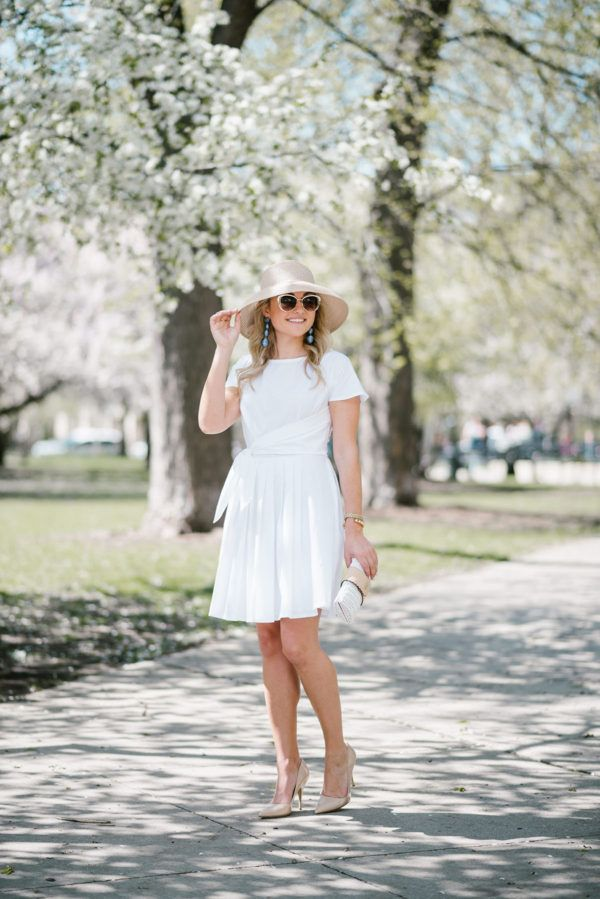 Little White Dress for the Kentucky Derby — bows & sequins. White tie-waist little dress+nude patent pumps+white and nude wicker clutch+blue bow nude straw sun hat+blue long earrings+sunglasses. Summer Derby Day or Semiformal Event Outfit 2017