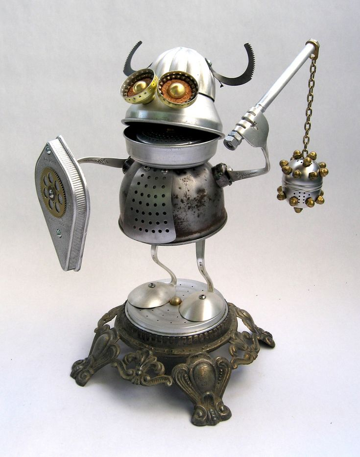 https://flic.kr/p/7J46xF   Alrik - Found Object Robot Assemblage Sculpture by Brian Marshall   Robot sculpture assembled from found objects by Brian Marshall - Wilmington, DE.  Items included in my sculptures vary from vintage household kitchen items to recycled industrial scrap.  Some of my favorite items to use are old oil cans, aluminum measuring spoons, electrical meters, retro blenders, anodized cups, and pencil sharpeners.