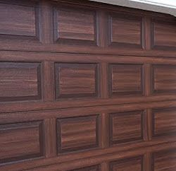 You Can Paint A Steel Garage Door To Look Like Wood