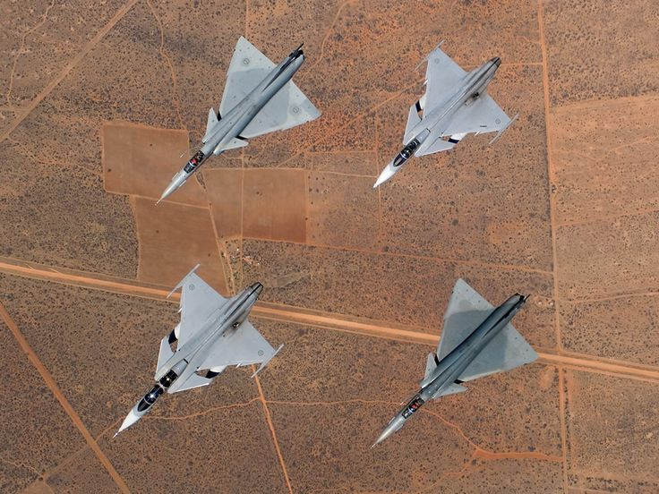 Formation of old and new South African Air Force fighters; two SAAB JAS-39 Gripens and two Atlas Cheetahs.