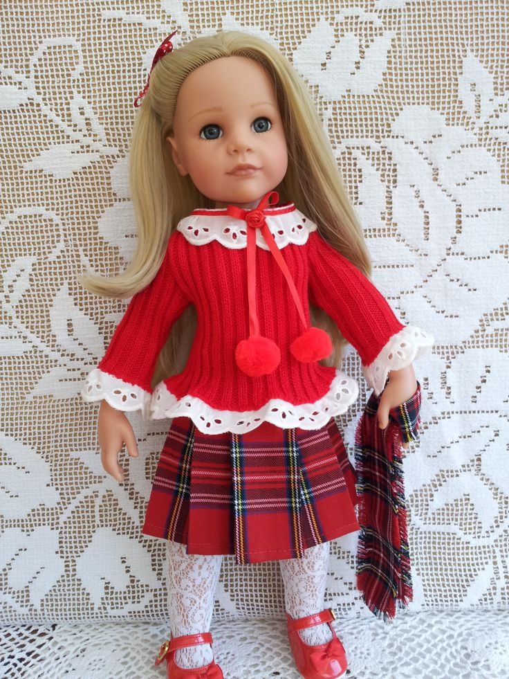 Red Knit Ribbed Jumper with broderie anglaise and pompoms, Red Tartan Pleat Skirt, Lace Tights & Tartan Scarf.