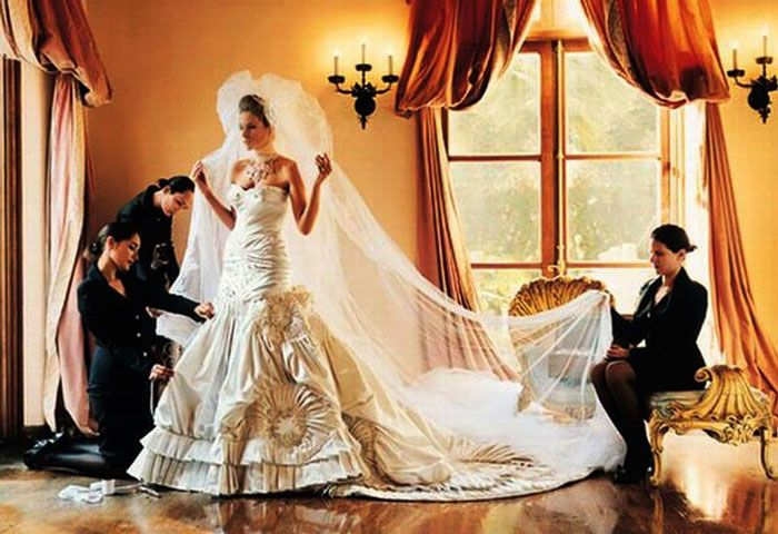 Photo via weddingdream.hu The Slovenia model Melanie Knauss wore an exquisite Christian Dior gown for her wedding to Donald Trump in 2005. Her dress is rumoured to cost upwards of $125,000! The garment was made out of 300 feet of tulle with upwards of 1500 pieces of pearl and rhinestone embellishments.