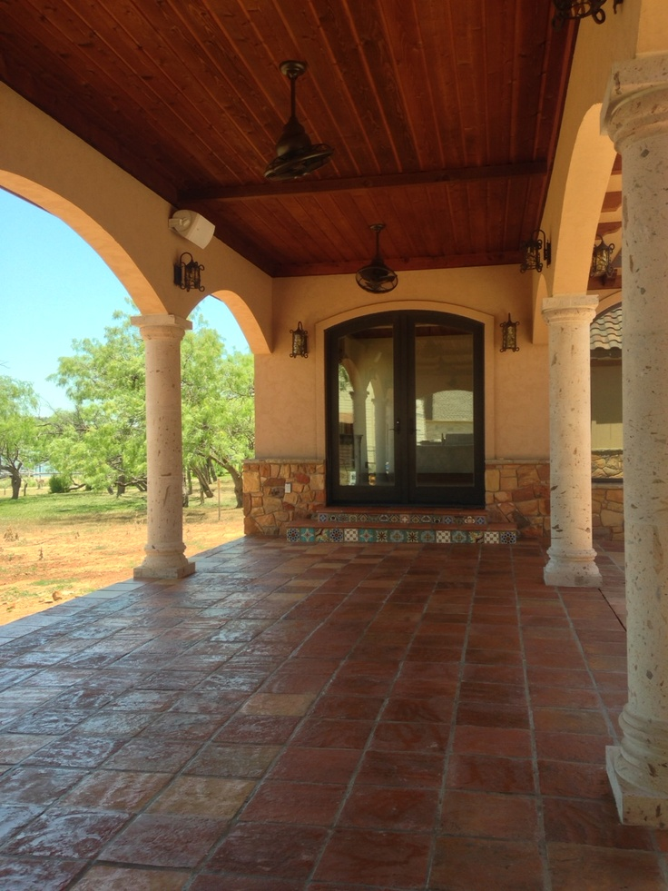 antique saltillo terracotta in the breezeway kind of big extravagant space but pretty tile and beams