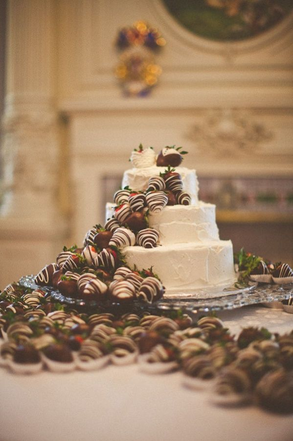 Buttercream cake decorated with #chocolatestrawberries! Photo by Hawes Photography