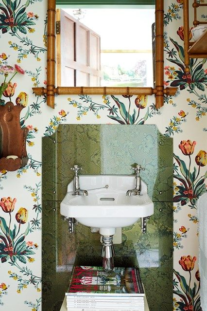Discover the best design ideas for bathrooms, including this small bathroom with floral wallpaper. A small bathroom has been papered with 'Botanical Tulips' a wallpaper by Twigs, available from Simon Playle. This is paired with bamboo furniture.