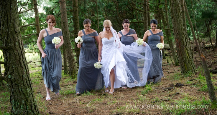 Bride and bridesmaids walking in a forest