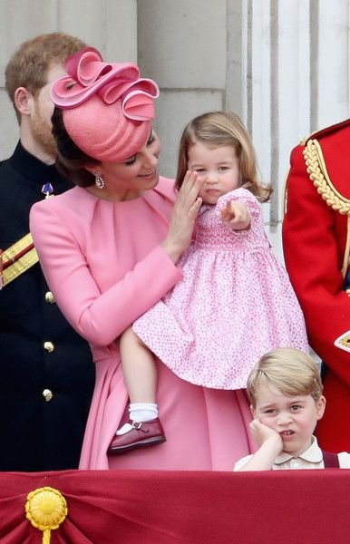 Prince Harry, Catherine, Duchess of Cambridge, Princess Charlotte of Cambridge and Prince George of Cambridge look out from the balcony of Buckingham Palace during the Trooping the Colour parade on June 17, 2017 in London.