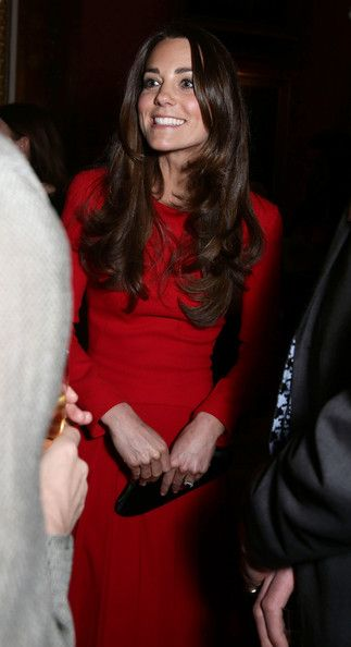 Catherine, Duchess of Cambridge meets performers during the Dramatic Arts reception at Buckingham Palace on February 17, 2014 in London, England.
