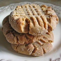 """No Flour!! Best Peanut Butter Cookies Ever (Allrecipes.com). Stir 2 c peanut butter& 1 1/2 c wh sugar till smooth, beat in 2 eggs (one at a time), stir in 2 tsp baking soda, pinch salt & 1 tsp vanilla. Form into 1"""" balls, roll in white sugar place on greased cookie sheet, press criss cross with back of fork. Bake 350 for 8-10 mins, leave on sheet 5 mins before moving to rack to cool completely."""