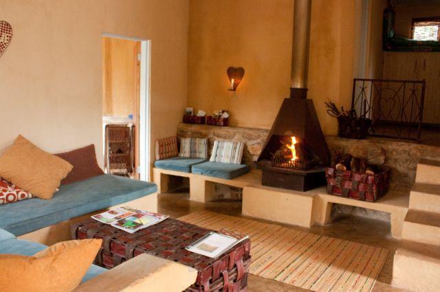 Legodi Cottage open plan kitchen lounge area with fire place