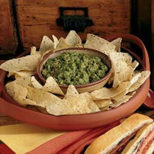 """Quick Guacamole Recipe -""""This delicious dip is extremely easy to make and always hits the spot when we have a craving for something to munch on,"""" assures Linda Fox of Soldotna, Alaska. """"For a quick recipe, it really has authentic guacamole taste."""""""