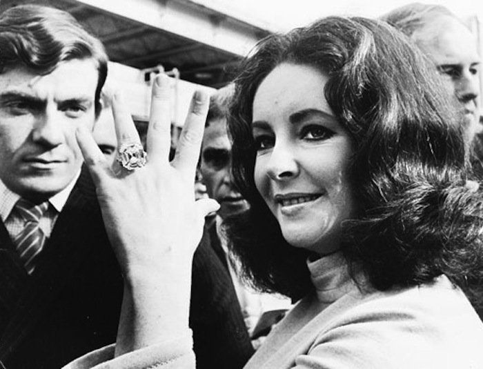 "Elizabeth Taylor says, ""my mother said that I didn't open my eyes for eight days after I was born, but when I did, the first thing I saw was an engagement ring and I was hooked."""