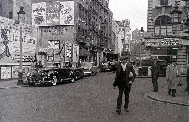 Old Compton St at the junction with Greek St, Soho, London, 5 November 1955     by allhails, via Flickr