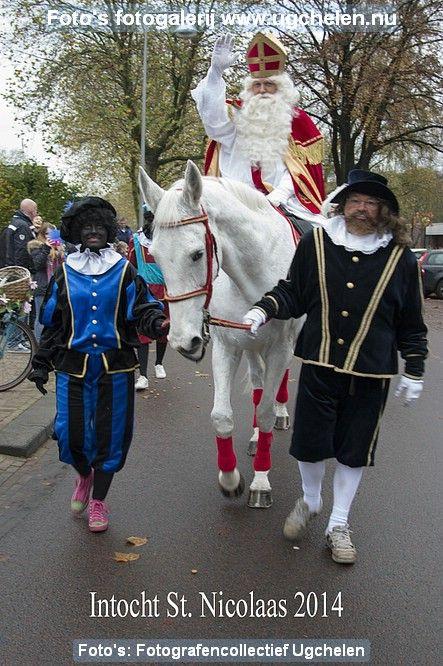 Sint op paard, Zwarte Piet en een Spaanse edelman. Intocht 2014 Ugchelen (Gelderland)