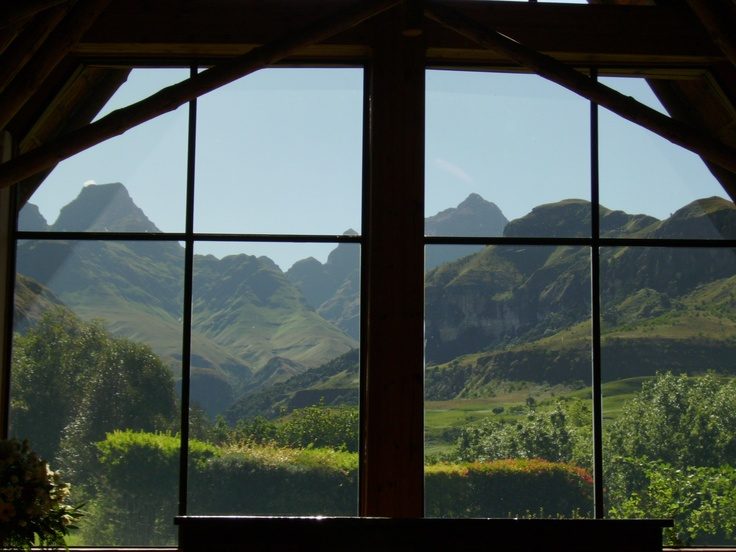 View of the Drakensburg mountains through the Wedding chapel window. Cathedral Peak hotel.