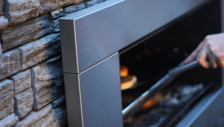 Escea Outdor Wood Fire (EW5000) with cooking plate.