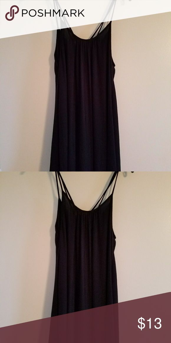 Adorable Roxy black dress Black dress or swim cover up by Roxy. Super cute trapeze fit with strappy details. Worn once for less than a hr. E UC Roxy Dresses