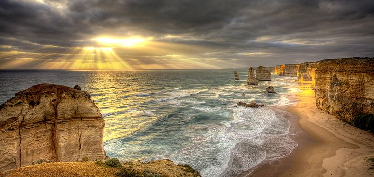 The 12 apostles near Great Ocean Road in Melbourne, Australia.  Melbourne's weather is known to have four seasons a day.  After heavy rain, the clouds start to shift, allowing for the natural light to shimmer through.  A truly amazing spectacle.: Natural Light, Clouds Start, Melbourne, Four Seasons, Australia, Heavy Rain