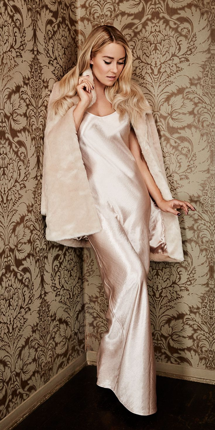 Capturing both timeless glamour and modern femininity, this silk chemise gown is a showstopper. For added drama, drape a luxe faux-fur car coat across the shoulders. Shop the complete LC Lauren Conrad Runway Collection at Kohl's.