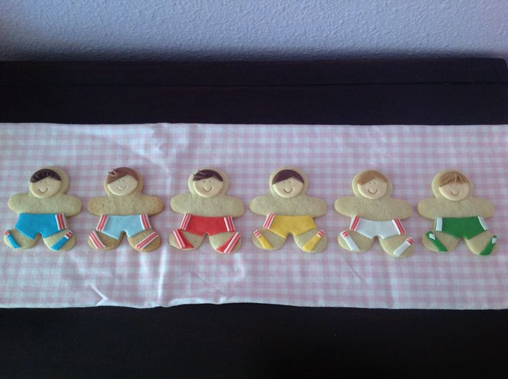 Boys in board shorts. Sugar cookies for summer holidays.