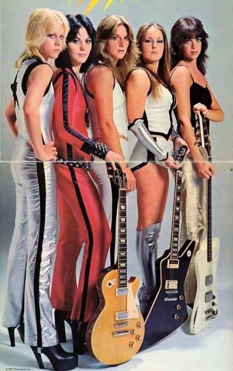 The Runaways = they look like superheroes, ready to take on intergalactic baddies with their epic guitars + platforms.