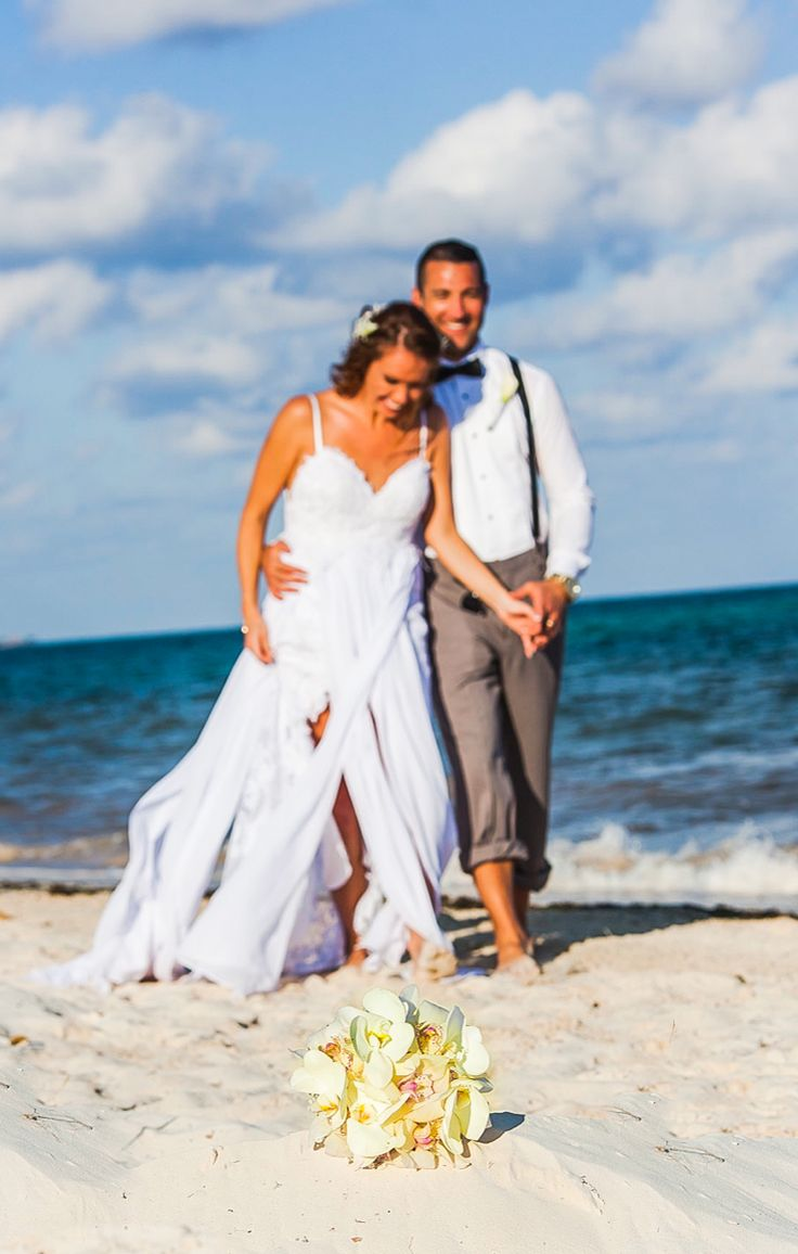 We LOVE The Flow Of This Beach Wedding Dress Bride And Groom On