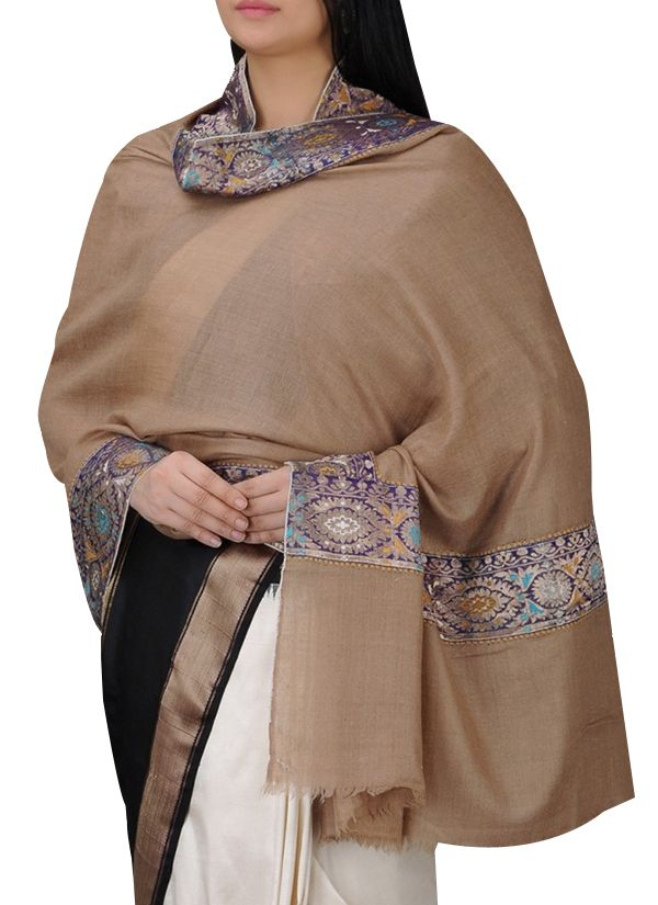 luxurious cashmere shawl by Absolute Pashmina in a timeless beige hue. The fabric in the border of this shawl is vintage and may have some stain marks and irregularities owing to natural decay and atmospheric elements. #pashmina #cashmere #india