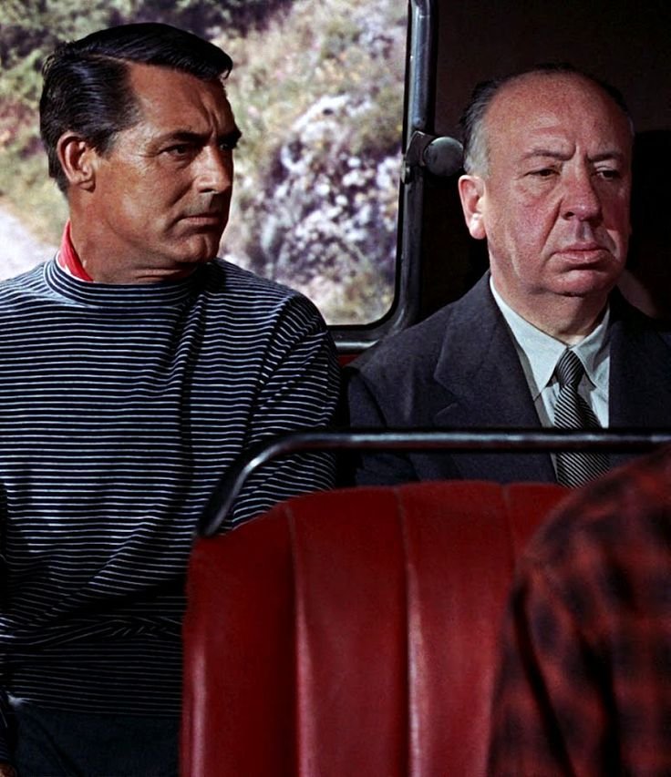 """Alfred Hitchcock's cameo role in """"TO CATCH A THIEF"""" sitting next to Cary Grant at the back of a bus. (1955)"""