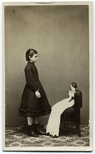 1880s  A girl and her doll.