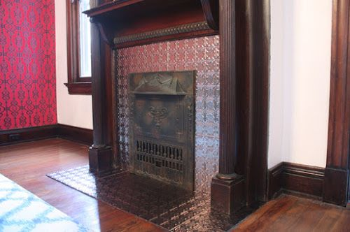 Faux tin tile fireplace makeover