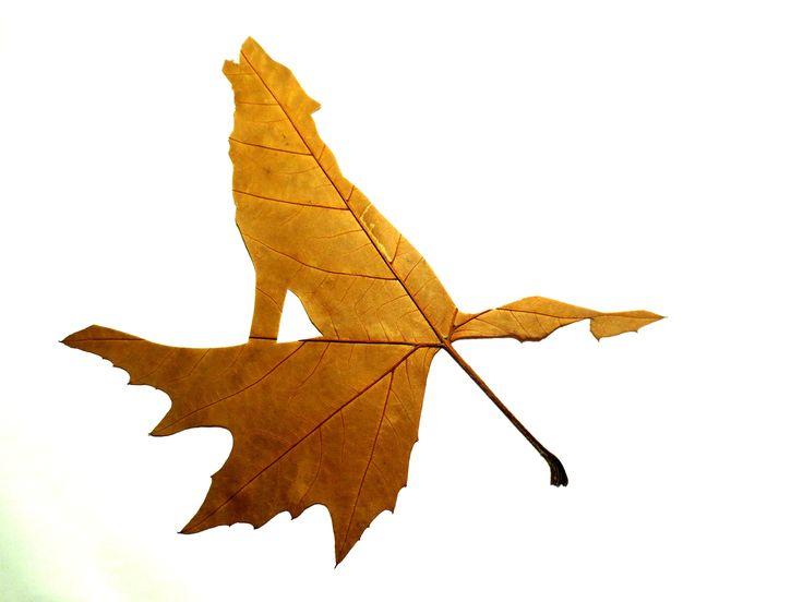 Fine Oddity - Howling Wolf hand cut from a leaf